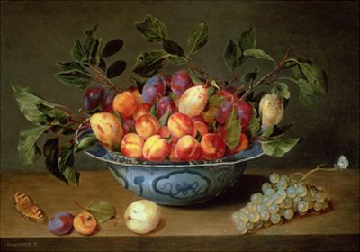 A Still Life of Plums and Apricots in a 'Wan-Li' Porcelain Bowl with a Bunch of Grapes and a…