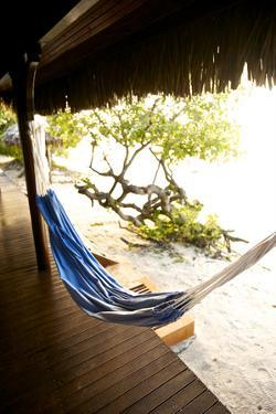 A Hammock Outside a Room At Medjumbe Island Resort in Mozambique by Jad Davenport