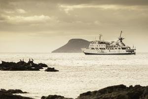 A Luxury Passenger Ship Sails around the Galapagos Islands by Jad Davenport