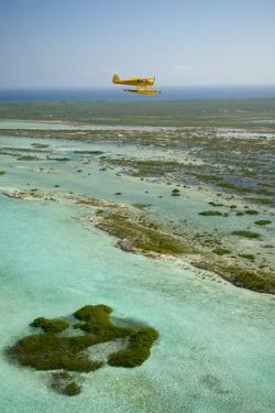 A PA18 Super Cub Floatplane Explores the Beaches of Conception Island by Jad Davenport