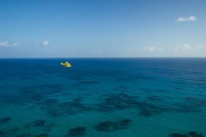 A PA18 Super Cub Floatplane Explores the Ocean Off Conception Island by Jad Davenport