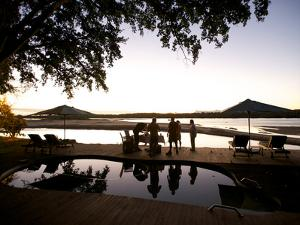 Drinks By the Pool At Lugenda Wilderness Camp in the Niassa Reserve by Jad Davenport