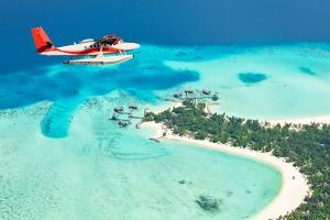 Sea Plane Flying above Maldives Islands by Jag_cz