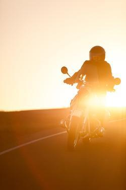 A Rider on 1960S Bmw R60Us Motorcycle on a Coastal Road at Sunset by Jak Wonderly