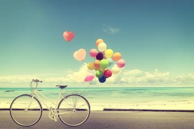 Bicycle Vintage with Heart Balloon on Beach Blue Sky Concept of Love in Summer and Wedding
