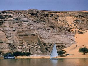 Boats on Nile River Passing Massive Statues of Pharoh Ramses II at Door to Queen Nefertari's Temple by James Burke