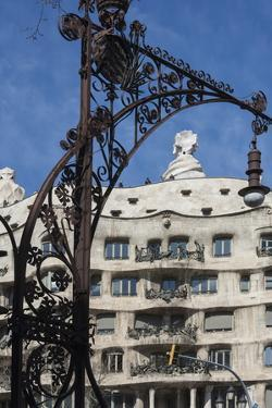 A Wrought Iron Lamp Frames La Pedrera (Casa Mila) by James Emmerson
