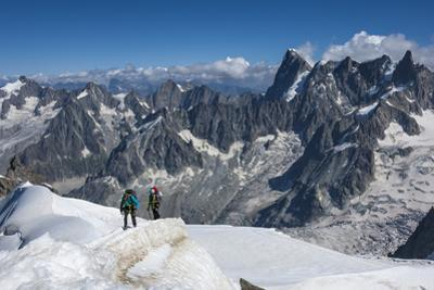 Climbers approaching the Tunnel to the Aiguile du Midi, 3842m, Graian Alps, Chamonix, Haute Savoie,