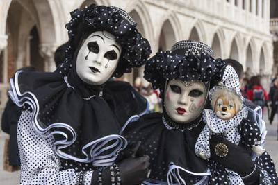 Couple in Black and White with Clown Puppet, Venice Carnival, Venice, Veneto, Italy, Europe by James Emmerson