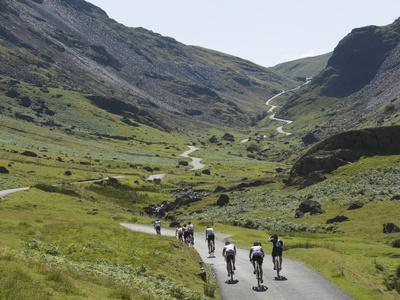 Cyclists Ascending Honister Pass, Lake District National Park, Cumbria, England, UK, Europe