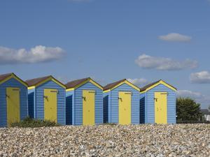 Five Blue Beach Huts with Yellow Doors, Littlehampton, West Sussex, England, United Kingdom, Europe by James Emmerson