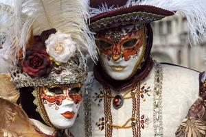 Lady and Gentleman in Red and White Masks, Venice Carnival, Venice, Veneto, Italy, Europe by James Emmerson