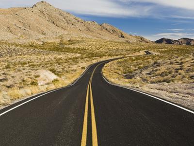 A Road Through and Arid Desert Landscape