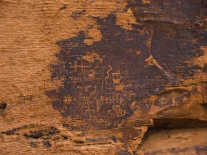 Ancient Native American Petroglyphs on a Sandstone Cliff by James Forte