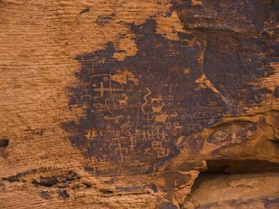 Ancient Native American Petroglyphs on a Sandstone Cliff