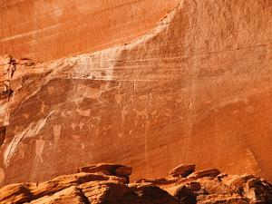 Ancient Navajo Petroglyphs on the Cliffs at Canyon De Chelly by James Forte