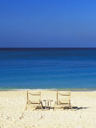 Beach Chairs Facing Blue Waters of the Carbbean