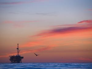 Offshore Oil and Gas Rig in the Pacific Ocean at Sunset by James Forte