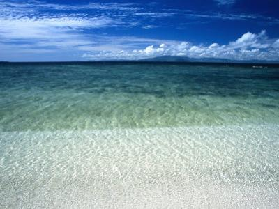 Secluded White Sands Beach on a Tropical Island with Blue Sky, Clouds