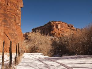 Tire Tracks in the Snow at the Canyon De Chelly Cliffs by James Forte