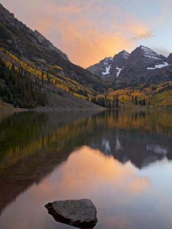 Maroon Bells with Fall Colors During a Clearing Storm in the Evening, White River National Forest by James Hager