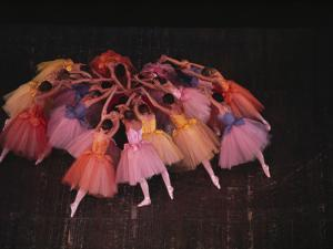Ballet Dancers in Colorful Costume Practice a Scene in the Nutcracker by James L. Amos
