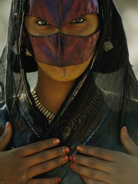A Bedouin Girl Wearing Saffron on Her Face to Give it a Yellow Cast by James L. Stanfield