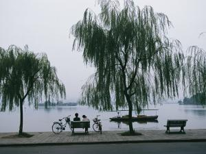 Bicyclists Enjoy the View in a Hangzhou Lakeside Park by James L. Stanfield