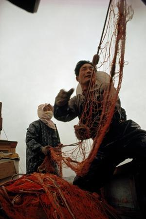 Husband and Wife Pull in their Gill Nets