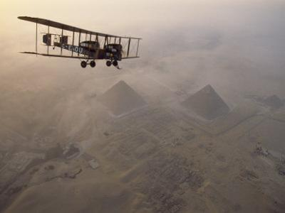 In the Light of Early Morning, The Vimy Circles the Pyramids at Giza on a Dawn Tour, Egypt by James L. Stanfield