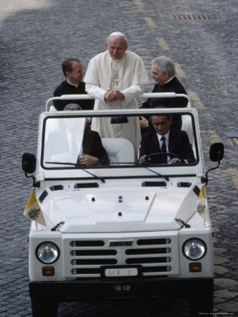 Pope John Paul II Rides in an Open-Air Vehicle by James L. Stanfield