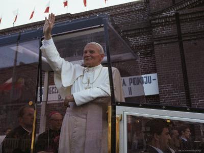 Pope John Paul II Waves from his Bulletproof Vehicle, Warsaw, Poland