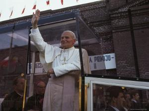 Pope John Paul II Waves from his Bulletproof Vehicle, Warsaw, Poland by James L. Stanfield