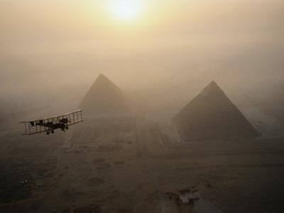 The Vimy Flies Above Fog-Shrouded Pyramids During a Golden Sunrise at Giza, Egypt