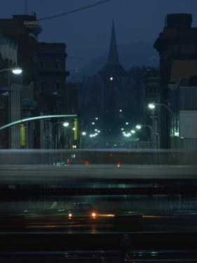 Train Whizzes by a Cumberland Street Crossing, Cumberland, Allegheny County, Maryland by James L. Stanfield