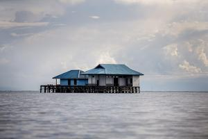 A House over the Ocean, Togian Islands, Sulawesi, Indonesia, Southeast Asia, Asia by James Morgan