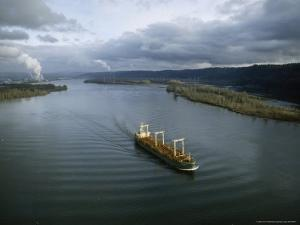 Aerial View of Freighter Transporting Logs on the Columbia River by James P. Blair