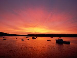 Fishing Boats Dot the Water at Twilight by James P. Blair