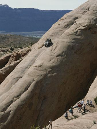 Jeep Drives Down a Slick Rock Formation Called Lion's Back, Utah by James P. Blair