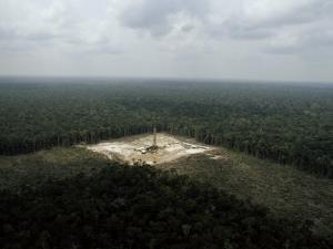 Oil Drilling Rig in the Rain Forest near the Rio Jurua, Amazon River Basin, Brazil by James P. Blair