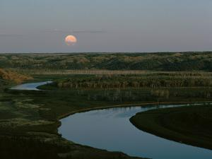 The Moon Rises over Low Hills Banking the Missouri River by James P. Blair
