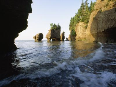 The Tide Flows Past Rock Formations in Rocks Provincial Park, Bay of Fundy, New Brunswick, Canada