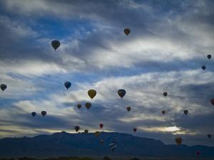 Balloons Soaring About Sandia Mountains During Albuquerque Balloon Fiesta by James Shive
