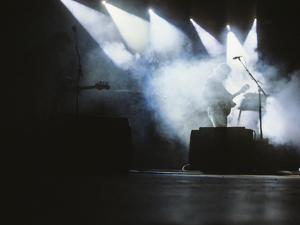 Guitarist on Stage with Smoke by James Shive