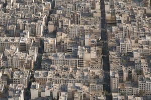 Aerial view of apartment and office buildings, Central Tehran, Iran, Middle East by James Strachan