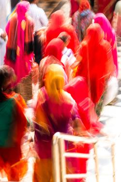 Brightly coloured saris (clothing) and veils, blurred in motion, India by James Strachan