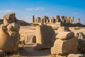 Broken bull column in foreground, Persepolis, UNESCO World Heritage Site, Iran, Middle East by James Strachan