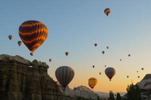 Hot Air Balloons Cruising over Cappadocia, Anatolia, Turkey, Asia Minor, Eurasia by James Strachan