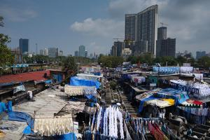 Slum Washing Ghats Surrounded by Expensive Residential Developments, Mumbai (Bombay), Maharashtra by James Strachan