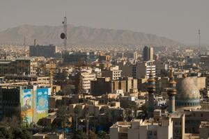 View over buildings from city centre towards Alborz Mountains, Tehran, Iran, Middle East by James Strachan